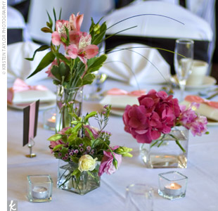 Clusters of pink hydrangeas, roses, and peonies in three or four vases brought color to the tables' centerpieces, which also featured a glow from tea light candles.
