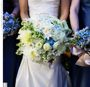 Cathy carried a pave-style bouquet with a mix of ivory peonies, roses, lilac, and stephanotis, mixed with blue hydrangeas. The stems were wrapped in light blue, satin ribbon.