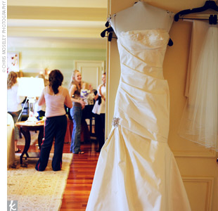 Cathy walked down the aisle in a strapless, ivory, silk taffeta gown by Amsale. The gown featured a dropped waist accented by a crystal applique and a flared skirt.