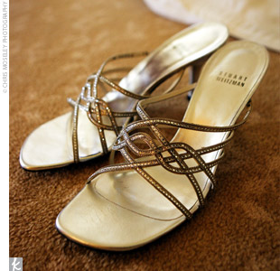 Cathy wore silver heels with beaded criss-crossing straps by Stuart Weitzman.