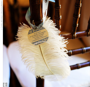 "Each fruitwood chiavari chair boasted an ivory damask cushion and also a white ostrich feather tied with a blue ribbon. Tags on the feathers instructed guests, ""At the kiss of the bride and groom, please wave your feather for a flight into happiness."""
