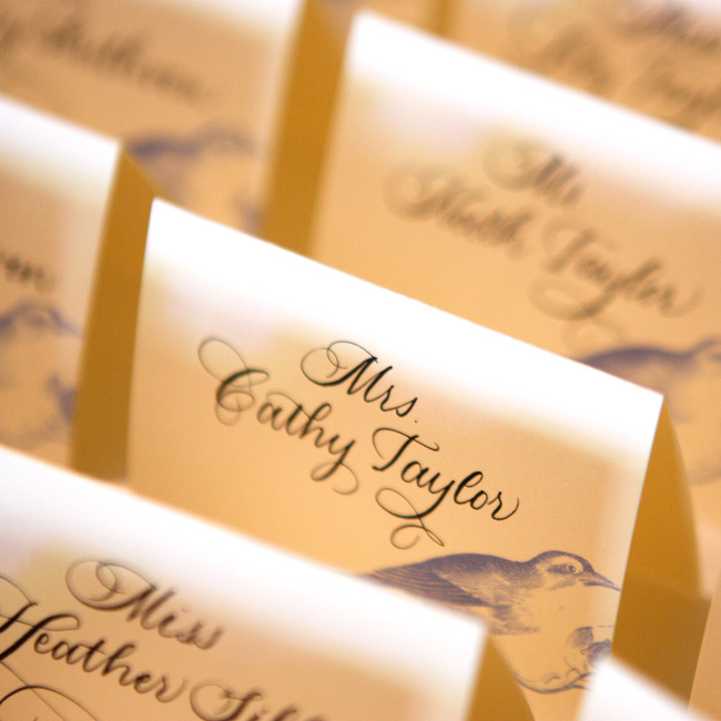 Cathy and Keith's guests found their seats from a display of escort cards set up in The Mansion's Promenade, where the cocktail hour was held. The cards, decorated with small bluebirds, featured hand-written calligraphy.