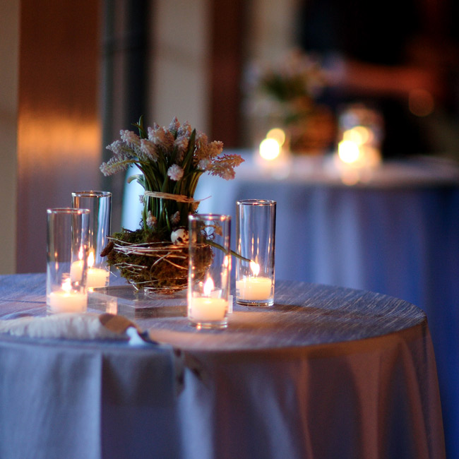 Dressed in iridescent taffeta, the cocktail tables were topped with tiny silver nests filled with blue Muscari, green moss, and tiny robin's eggs.