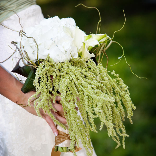 """We wanted everything to be very organic and natural, since we both love the outdoors and met at a summer camp,"" explains Rebekah. She carried a bouquet of white hydrangeas, white cymbidium orchids, curly willow, and hanging green amaranthus."
