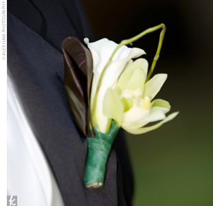 White orchids accented with curly willow gave even the boutonnieres a hint of the couple's organic-looking style.