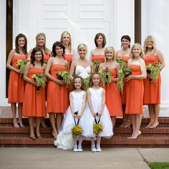Rebekah's 10 bridesmaids wore citrus orange, silk chiffon dresses from J.Crew's bridesmaid collection that were knee-length with an Empire waist.
