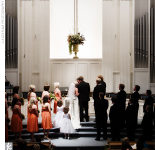 "Rebekah and Murrey married in a ""very traditional"" all-white church, which they decorated with a fresh, natural color scheme of greens, browns, oranges, and white. ""It has an open and fresh atmosphere that we were attracted to,"" says the bride. ""We wanted an outdoorsy and easygoing feel to our whole event."""