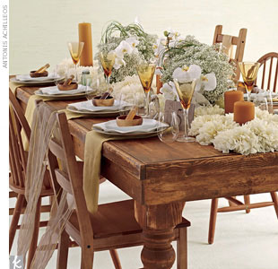 Set an eco-friendly table using certified organic baby's breath and locally grown phalaenopsis orchids arranged in sustainable bamboo containers on a bed of locally grown dahlias. Paraffin-free beeswax pillar candles; handmade glass bottles; small wood bowls made from sustainably forested acacia wood; and raw silk scarves bring the vision to life.  ...