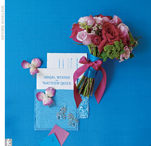 If a certain flower color (in this case blue) is hard to find and use in your bridal bouquet, ask your florist to incorporate the color using a ribbon. Then find complementary, in-season blooms for your bouquet. 