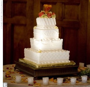 The bottom three layers of their four-tiered confection were made of all white cake with both cheesecake and raspberry fillings. The top layer was red-velvet cake with layers of cream cheese filling.