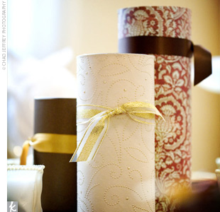 Half of the reception tables were decorated with candle-filled cylinder vases wrapped in fall-themed scrapbook paper.