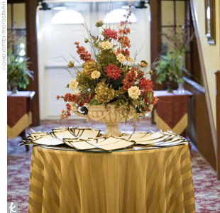 To complete her fall-inspired look, Jennifer chose gold, floor-length linens and gold chargers, which showcased the lavish floral centerpieces.