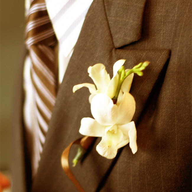 Danny wore a boutonniere of green hydrangeas with a few ferns, while his groomsmen sported green dendrobium orchids.