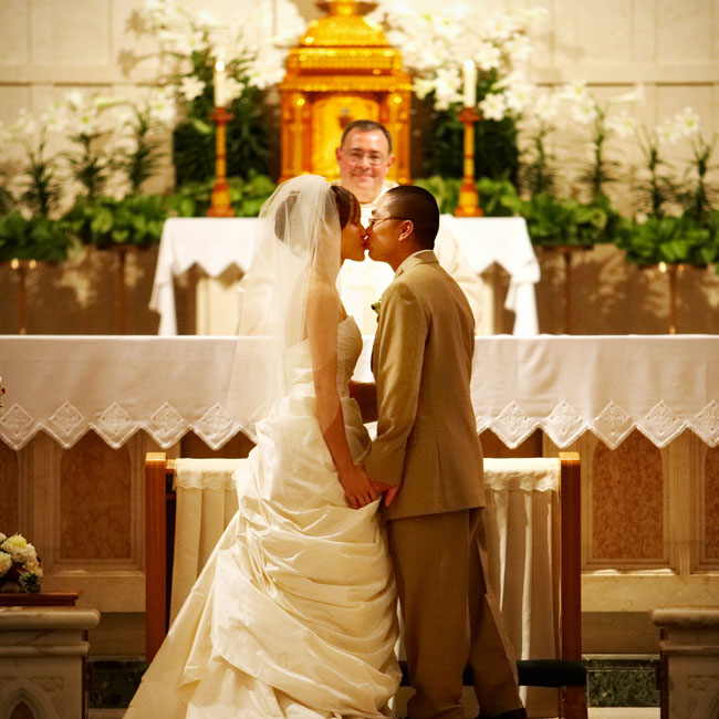 "Ivy and Danny married in a Catholic ceremony with traditional vows. The intimate ceremony included just 80 of their closest friends and family members. ""It was raining and hailing outside, but inside it was nice to see the people that we care for attend the ceremony,"" the bride says."
