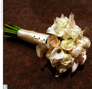The bridesmaids carried bouquets of calla lilies and roses with ivory wraps accented with black pearls.