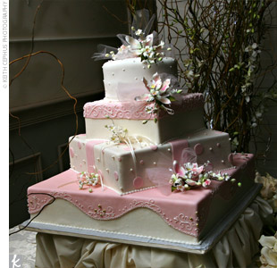 The four-tiered ivory and pink cake featured vanilla icing and almond flavored cake.