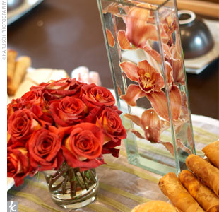 The banquet-style tables were also decorated with small round centerpieces of roses and a few orchids submerged in tall rectangular vases.
