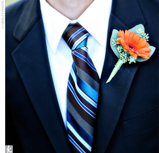 Sam and his groomsmen wore single orange gerbera daisies on their lapels.