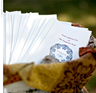 White programs featuring a custom design with the couple's names incorporated the brown and blue color palette.