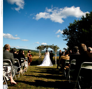 The couple exchanged handwritten vows under a birch-bark arbor overlooking Newfound Lake. The nondenominational ceremony included a passage by Chilean poet Pablo Neruda and music performed by Sarahs good friend and coworker.