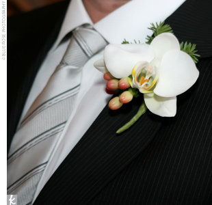 Christopher wore a single white orchid on his lapel.