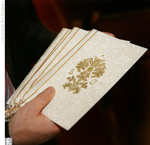 Cream and white patterned paper with a gold emblem outlined the personalized ceremony.