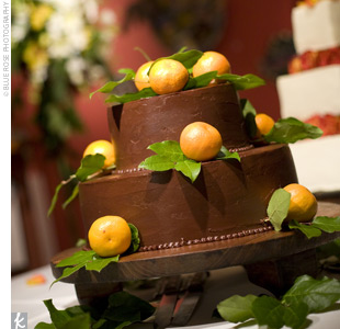 The groom's three-tiered, chocolate buttercream cake was filled with dark chocolate and Grand Marnier and layered with orange filling. Small mandarin oranges decorated each layer.