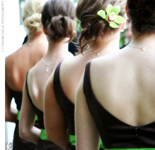 Julies four bridesmaids wore chocolate brown tea-length gowns by Jim Hjelm. The dresses were accented with a bright lime sash to bring a springy feel to the chocolate satin, the bride says.