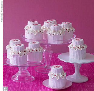 Have all your guests talking with pink-and-white, monogrammed miniature cakes. Serve them as dessert, or lighten the mood and have them passed around to enjoy during the cocktail hour.