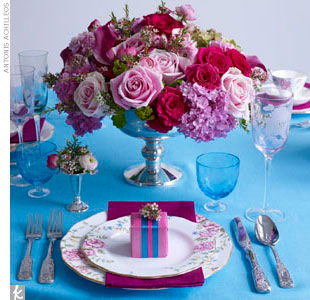When it comes to the reception tables, alternate the table linens and place settings to get a coordinated (but not too matchy) look. No matter what you decide to give as favors, make sure your favor boxes look the part with coordinating gift wrap. Finally, top off the tables with lush floral arrangements. 