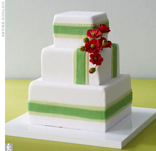 When it comes to the cake, mimic the bold, layered look of the table with white fondant accented with green stripes and small sugar poppies.