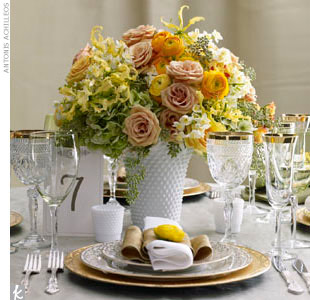 Get lush, luxe centerpieces with a vintage hobnail vase filled with safari roses, hydrangeas, yellow ranunculuses, gloriosa lilies, and narcissus.