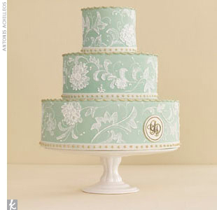 To get a wedding cake like this one (with rolled fondant, royal icing embroidery, and gold crimped tiers) that both steals the spot light and looks the part, send your cake baker a copy of your invite to use as a guide.