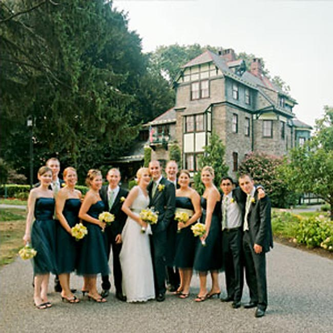 Lauren's five bridesmaids wore strapless, navy blue, satin, tea-length dresses by Dessy. Since neither Lauren nor Gilles was crazy about tuxedos, they instead had their groomsmen wear navy suits with white shirts. They all wore sage and navy neckties by Michael Kors, the couple's gift to their male attendants.