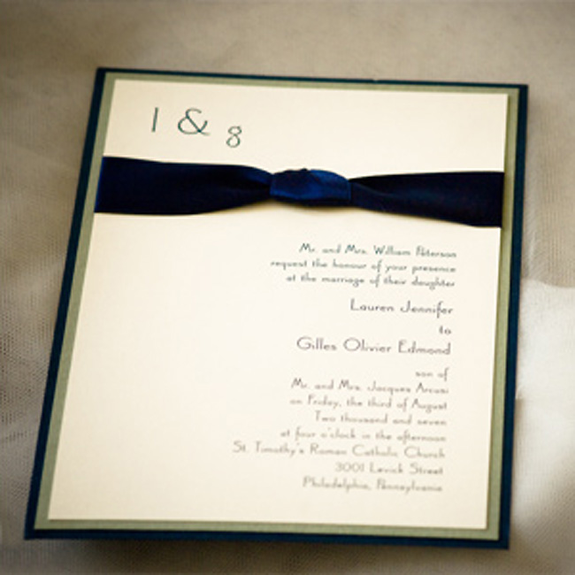 Lauren and Gilles' invitations introduced their guests to their subtly stylish theme. The navy blue ribbon trim matched the bridesmaid dresses perfectly.