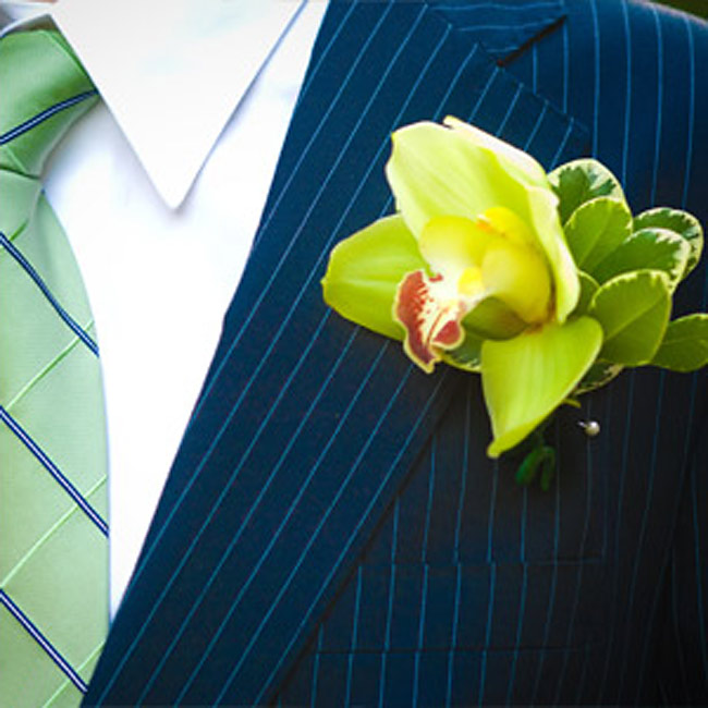 Gilles and his groomsmen sported green orchids on their lapels.