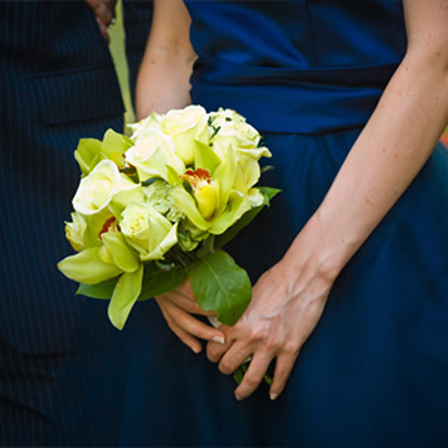 Lauren's bridesmaids held pale green bouquets of orchids, roses, and hydrangeas that were a beautiful contrast to the deep blue of their dresses.
