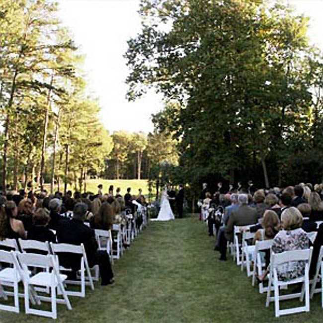 "Abbey and John exchanged vows on the lawn of the country club overlooking the 18th fairway. A quartet provided music, and the couple arranged for a special reading, ""Falling in Love is Like Owning a Dog,"" to honor their love of dogs."