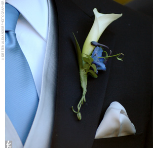 John wore a single miniature calla lily accented with a blue delphinium on his lapel.