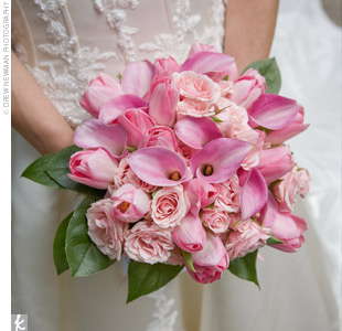 Alison carried a lush cluster of pink roses, calla lilies, and tulips accented with greenery.