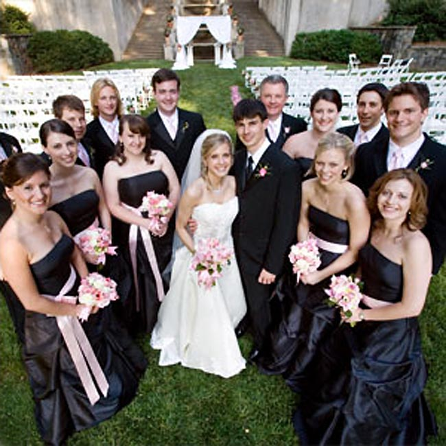 Alison's six bridesmaids wore strapless, floor-length dresses tied off with pink sashes by Bill Levkoff. Chris' six groomsmen wore black tuxes and pink ties to coordinate with the maids' sashes.