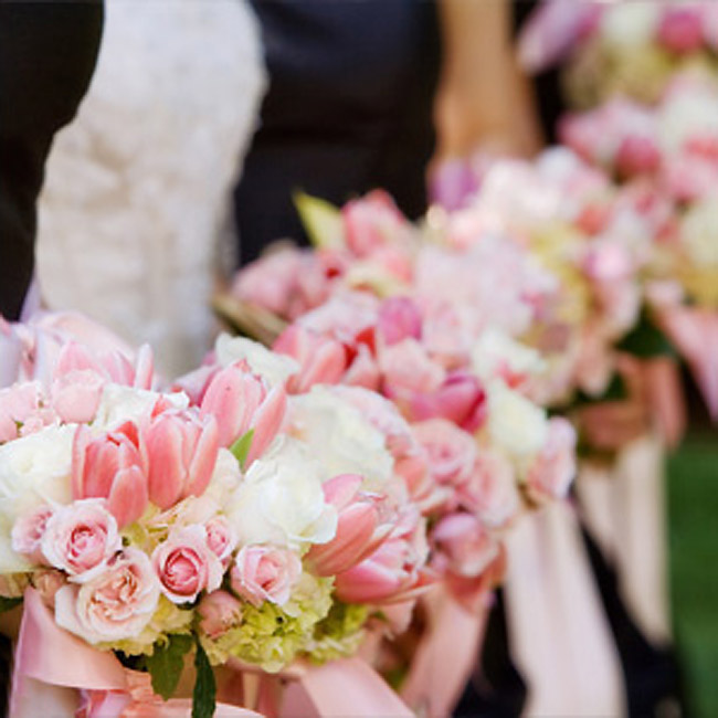 Alison's bridesmaids carried clusters of pink roses and tulips mixed with white roses and green hydrangeas. The bouquets were tied off with pink ribbon to match the pink sashes on the maids' dresses.