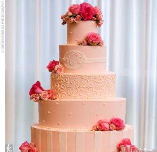 Alison and Chris cut into a five-tier pink and ivory cake topped with fresh pink roses. Each layer was decorated in a slightly different style, ranging from subdued stripes to Swiss dot designs.