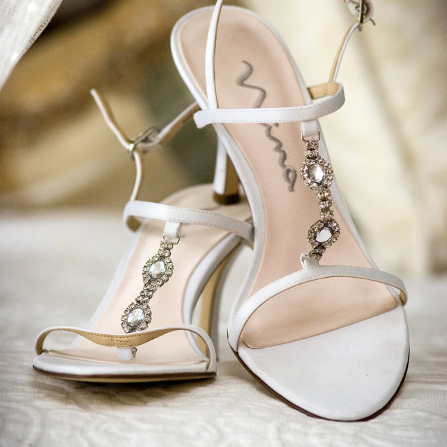 One of the hardest parts of putting together her look was finding the right heels. She finally found her strappy, low-heeled sandals the week of the wedding.