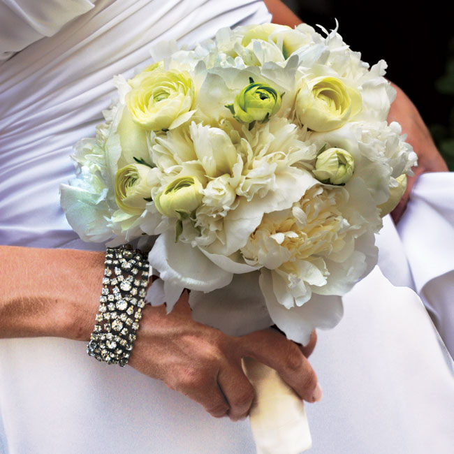 Alison held a small cluster of white ranunculuses and peonies tied together with a white ribbon.