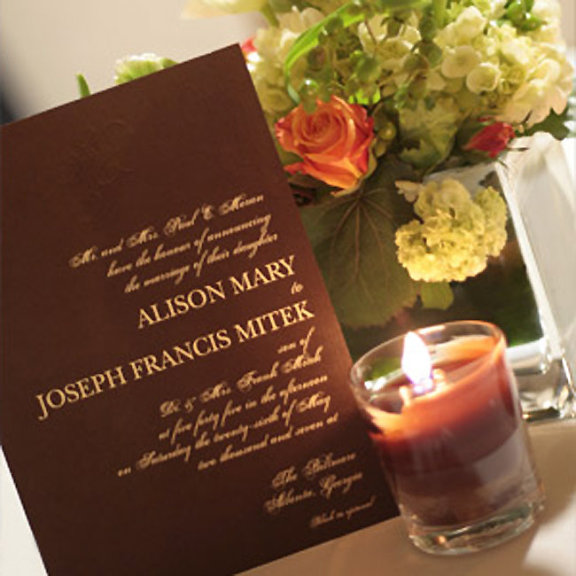 Alison and Joe kept their invitations simple and elegant with chocolate brown paper featuring ivory script and their initials embossed at the top.