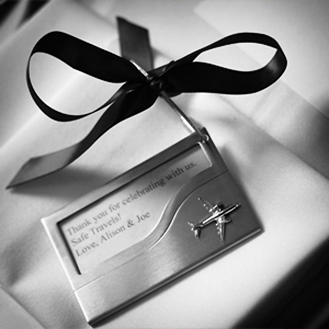 Since most of their guests were from out of town, Alison and Joe gave out sterling silver luggage tags with a personalized thank-you note from the couple.