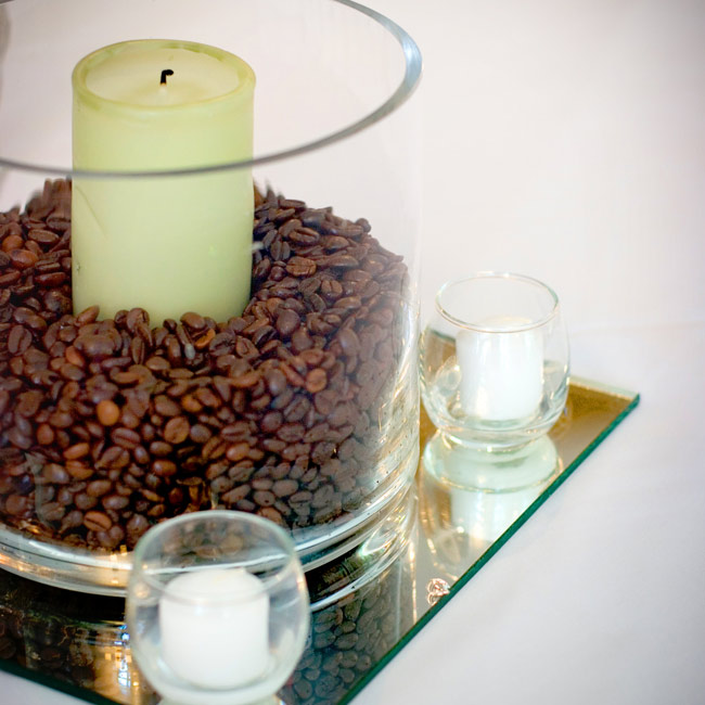 The centerpieces varied from table to table -- some were round glass vases filled with coffee beans and a candle, and others were tall vases filled with greenery and branches.