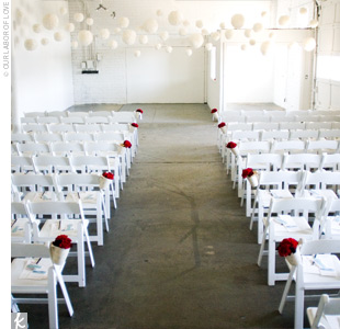 Ashley and Dusty's ceremony was held in a gallery space decorated with white Chinese lanterns that Ashley had covered with paper cupcake liners and hung with baker's twine from the ceiling.