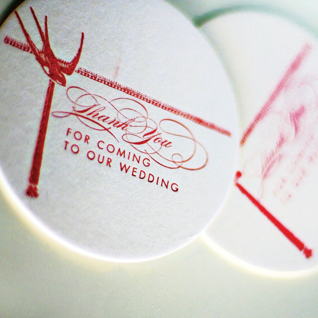 Ashley and Dusty had all of their wedding day stationery custom-designed to feature a bright red bird motif and the colors of the day: light blue, chocolate brown, and bright red.